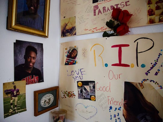 "Photos and memorial posters hang in Katrina Johnson's home on Thursday, Oct. 12, 2017, in Burlington. ""He knew the words to say to make a person feel good about themselves,"" Johnson said of her son Kedarie who was killed over a year and a half ago."