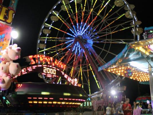 636677028725785856-763f4d1e2205dab8ca7b42e107b518d1ca905aa8-ozark-empire-fair-2011-rides---Copy.jpg