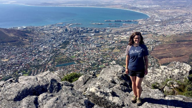 Addison Mauck from Detroit took the D to Cape Town, South Africa. She is standing on the edge of Table Mountain having just hiked up to see the views of the ocean and city below in March 2017. In the back left of the photo you can see Cape Town Stadium, where South Africa hosted the 2010 FIFA World Cup. She is studying at the University of the Western Cape and volunteering with an NGO that empowers women entrepreneurs. Her time there is coming to a close and she will be returning to Detroit soon.
