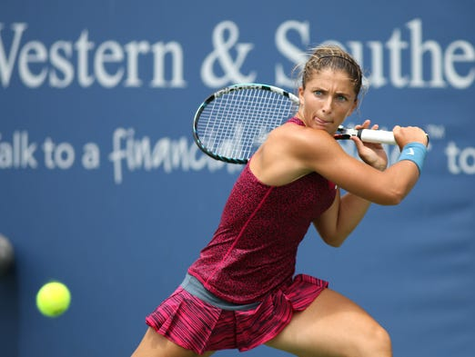 Sara Errani hits the ball while playing Yanina Wickmayer on the grandstand court at the Western and Southern tennis tournament at the Lindner Family Tennis Center in Mason on Tuesday, August 11, 2014.