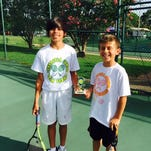 Creative Learning Academy's Darion Lopez (left) and Carlo Ghiglino (right) won first-place trophies at the Pensacola Junior Team tennis party.