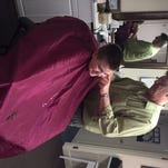Lou DiFrancesco cuts the hair of a young customer at the Pittsford Barber Shop.