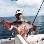 Frank Troha holds the biggest mangrove snapper he's ever caught -- 26 inches, 25 miles out on a shrimp.