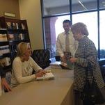 "Mary Fullmer gets her copy of Ann Romney's new book ""Romney Family Table"" signed at Deseret Books in Cedar City on Thursday."