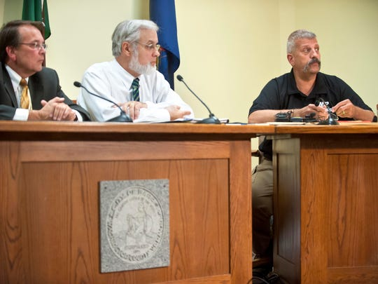 City of Barre officials discuss a rash of supected arson fires at a news conference on Tuesday. From left to right are Mayor Thomas Lauzon, City Manager Steven Mackenzie and Police Chief Timothy Bombadier.        GLENN  RUSSELL /FREE PRESS