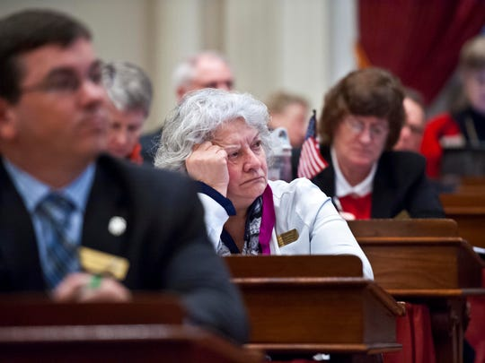 Rep. Connie Quimby, R-Concord, listens as Gov. Peter Shumlin delivers his budget address.