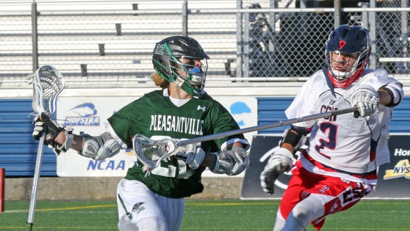 Pleasantville's Brian Reda (22) keeps the ball was