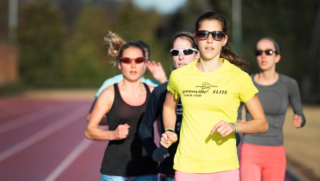 Kimberly Ruck runs with other members of the Greenville Track Club Elite team on the track at Furman University on Wednesday, December 7, 2016.