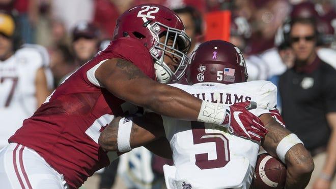 Alabama linebacker Ryan Anderson (22) tackles Texas A&M running back Trayveon Williams (5) at Bryant-Denny Stadium in Tuscaloosa on Saturday, October 22, 2016.