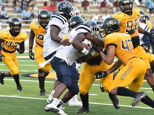 Grambling gang-tackles a Jackson State running back