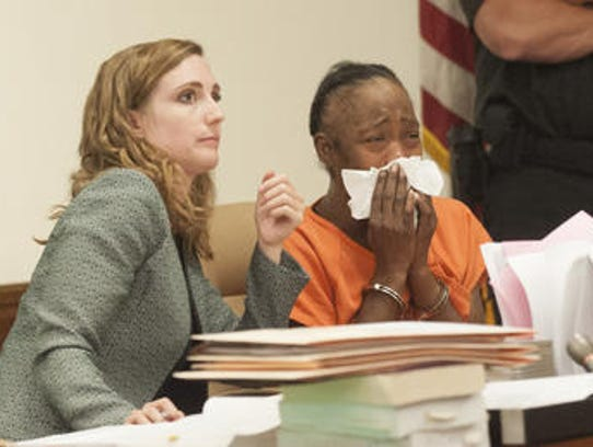 Carhia Fisher, right, sobs as she sits with attorney