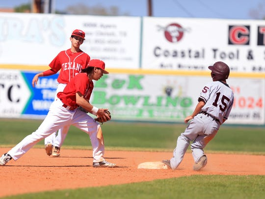 Calallen's Zach Almendarez steals second base as the ball arrives late to Ray's Antonio Valdez during the third inning of the game at Cabannis on Tuesday, March 14, 2017.