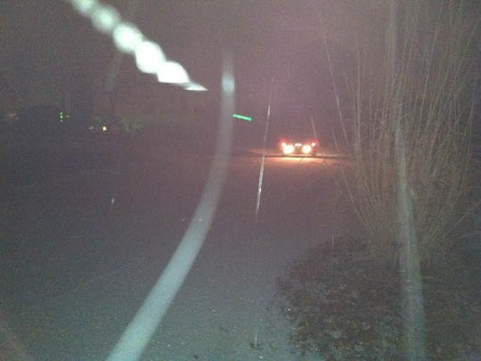 A car trying to make it up Candler Knob Road.