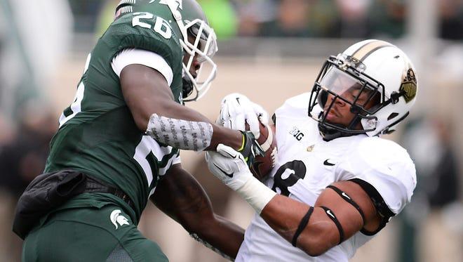 MSU's RJ Williamson takes down Purdue running back Markell Jones at Spartan Stadium Saturday.