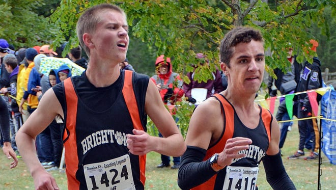 Chip Osborne (left), a former Brighton High School runner, set the 5K record in the Hungry Duck Run.