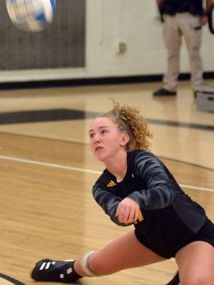 Newton freshman libero Abby Koontz digs out a ball during play Tuesday against Maize South. Newton finished the day 1-1.