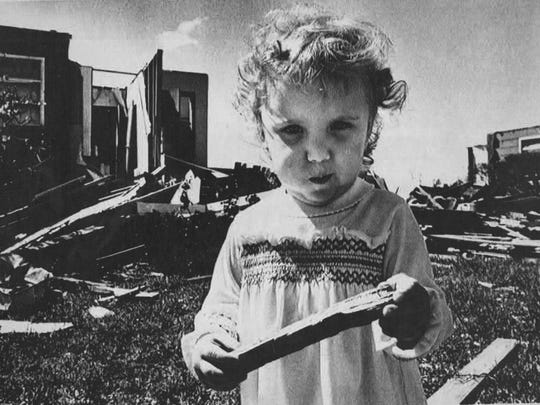 Puffing her cheeks, 2-year old Tricia Whyrick of Wichita