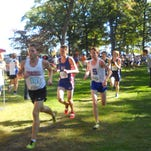 Salem senior Noah Engerer (right) competes at the Coaching Legends Classic in Brighton. He ran a lifetime best 16:51.