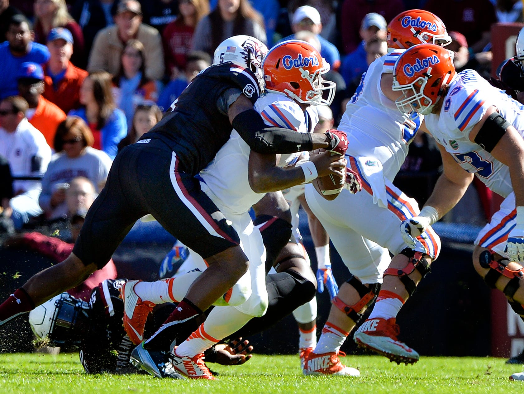 USC defensive end Darius English (5) sacks Florida quarterback Treon Harris (3) late in the first half at Williams-Brice Stadium in Columbia on Nov. 14, 2015.