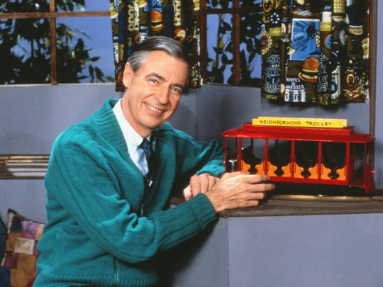 """Fred Rogers poses with the Neighborhood Trolley on his show, """"Mister Rogers' Neighborhood."""""""