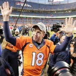 Jan 24, 2016; Denver, CO, USA; (EDITORS NOTE: caption correction) Denver Broncos quarterback Peyton Manning (18) greets father Archie Manning and brother Cooper Manning after defeating the New England Patriots in the AFC Championship football game at Sports Authority Field at Mile High. Mandatory Credit: Mark J. Rebilas-USA TODAY Sports