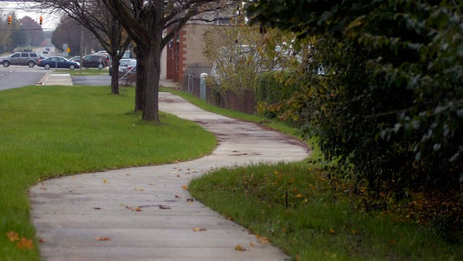 In most communities, it's the homeowner responsible for sidewalks in front of the house.