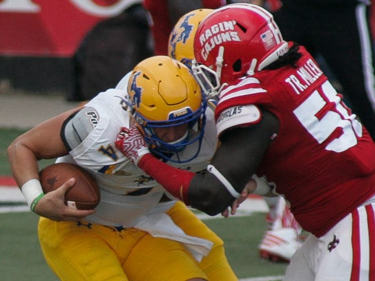 UL defensive end Trev Miller tackles McNeese State's