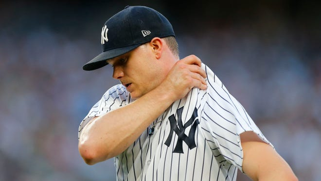 Jun 30, 2018; Bronx, NY, USA;  New York Yankees starting pitcher Sonny Gray (55) goes to the dugout between inning against the Boston Red Sox at Yankee Stadium.