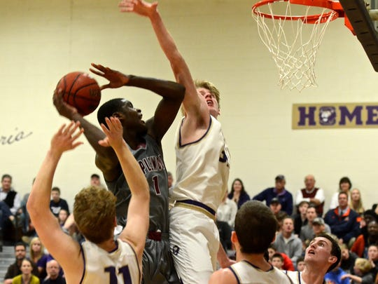 Maplewood's Bo Hodges (1) elevates for a layup as CPA's