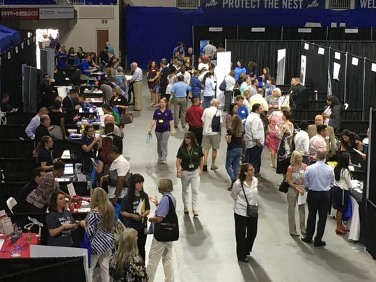 Job seekers packed into the Alico Arena for a regional career fair in 2018.
