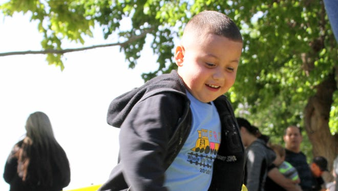 Emanuel Padilla, 4, takes his turn at the CASA Hula Hoop venue during one of many community events  CASA volunteers participate in.