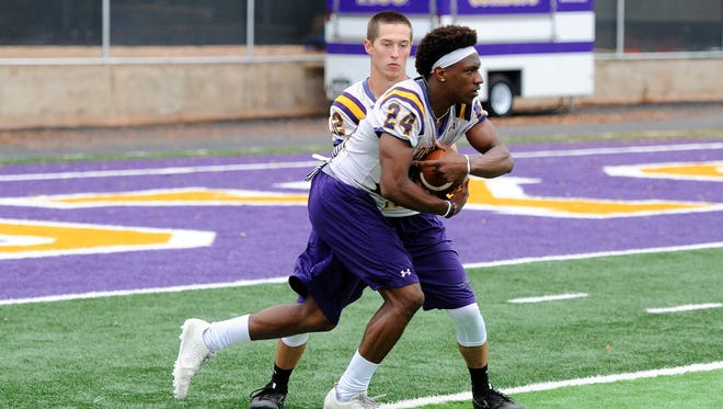 Hardin-Simmons running back Jaquan Hemphill gets the ball from quarterback Ty Hooper during the Cowboys' first spring practice at Shelton Stadium on Tuesday, March 27, 2018.