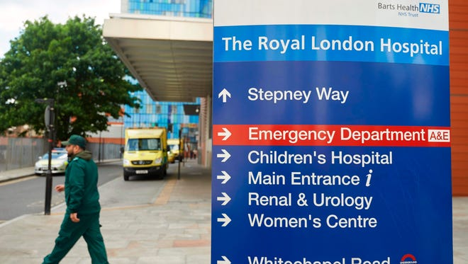 Signage is seen outside The Royal London Hospital in London on May 14, 2017, which was among places hit by a global cyberattack.