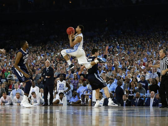 North Carolina Tar Heels guard Marcus Paige launches