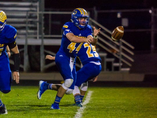 Parowan quarterback Porter Wood (44) pitches the ball to a running back during Friday's game against Wayne, September 29, 2017.