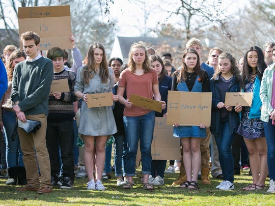 Over 150 students at Wilmington Friends School gathered under the school's American flag at noon for 17 minutes, one minute for every life lost in the mass shooting at Marjory Stoneman Douglas High School in Parkland, Florida.