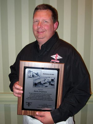 Kevin Jorgensen of Waupun was awarded the prestigious 2014 Pioneer Award from East Central/Select Sires.