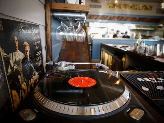 A record player sits at the bar at Harbinger on Ingersoll