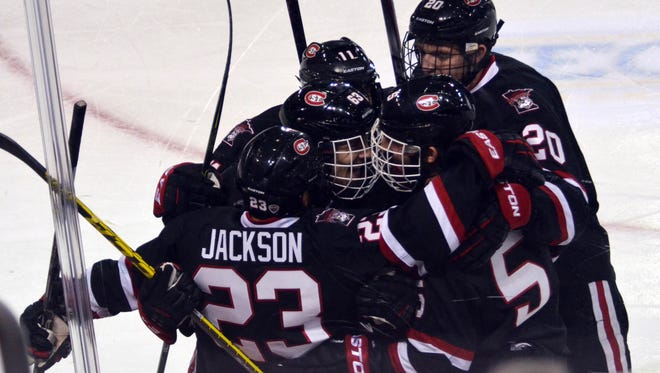 St. Cloud State's Robby Jackson (23) celebrates one of his two first-period goals with teammates Saturday at Sullivan Arena in Anchorage, Alaska.