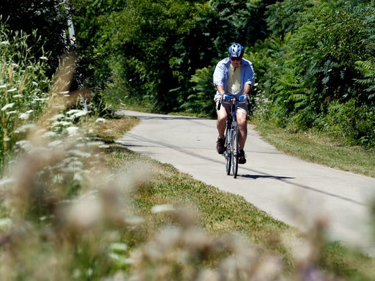 A biker rides along the Oak Leaf Trail through Brown