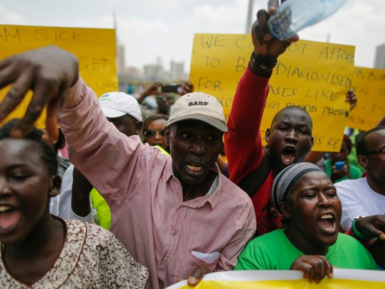 Kenyan activists shout slogans against the country's