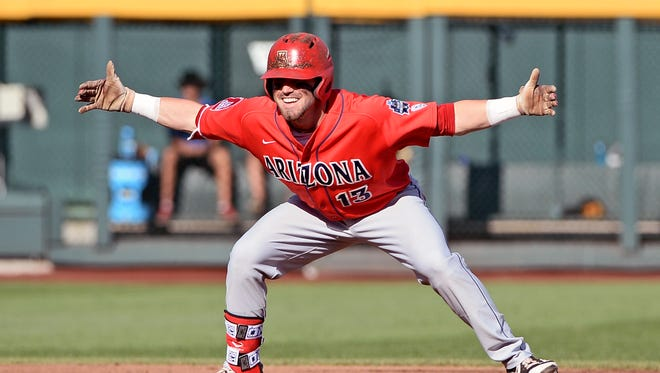 Jun 27, 2016: Arizona second baseman Cody Ramer (13) reacts after hitting a double during the first inning against the Coastal Carolina Chanticleers in game one of the College World Series championship series at TD Ameritrade Park.