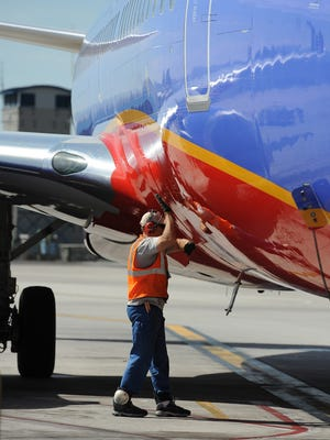 A worker readies a Southwest Airlines airplane at Reno Tahoe International Airport April 9, 2014.