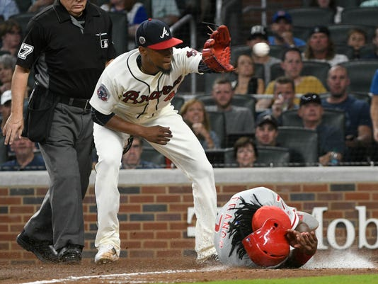 Philadelphia Phillies' Maikel Franco scores sliding into home plate as Atlanta Braves pitcher Julio Teheran (49) catches a throw from catcher Tyler Flowers at the backstop during the fifth inning of a baseball game, Saturday, Sept. 23, 2017, in Atlanta. (AP Photo/John Amis)