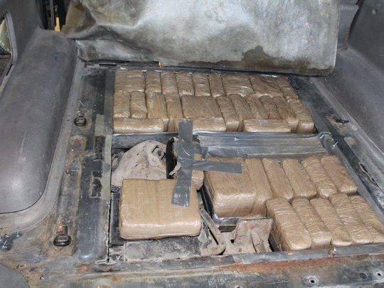 El Paso police found more than 50 pounds of marijuana hidden inside the rear cargo area of a vehicle.