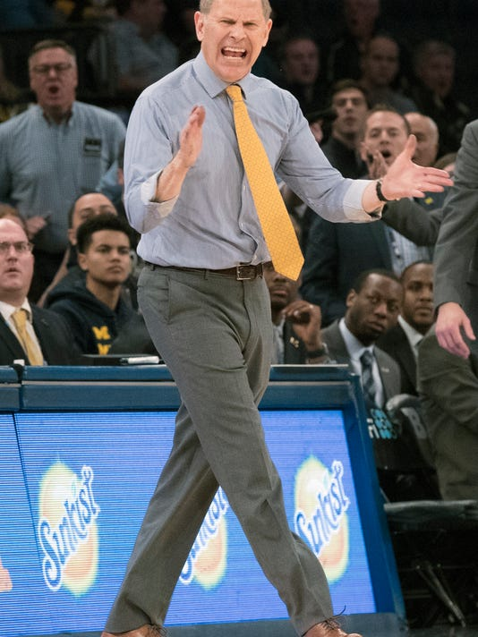 FILE - In this March 1, 2018, file photo, Michigan head coach John Beilein gestures during the second half of an NCAA college basketball game against Iowa in the second round of the Big Ten conference tournament at Madison Square Garden in New York. Beilein has stood the test of time in basketball, coaching since the mid-1970s and earning one of the best reputations in the game as a teacher and a man of integrity. (AP Photo/Mary Altaffer, File)