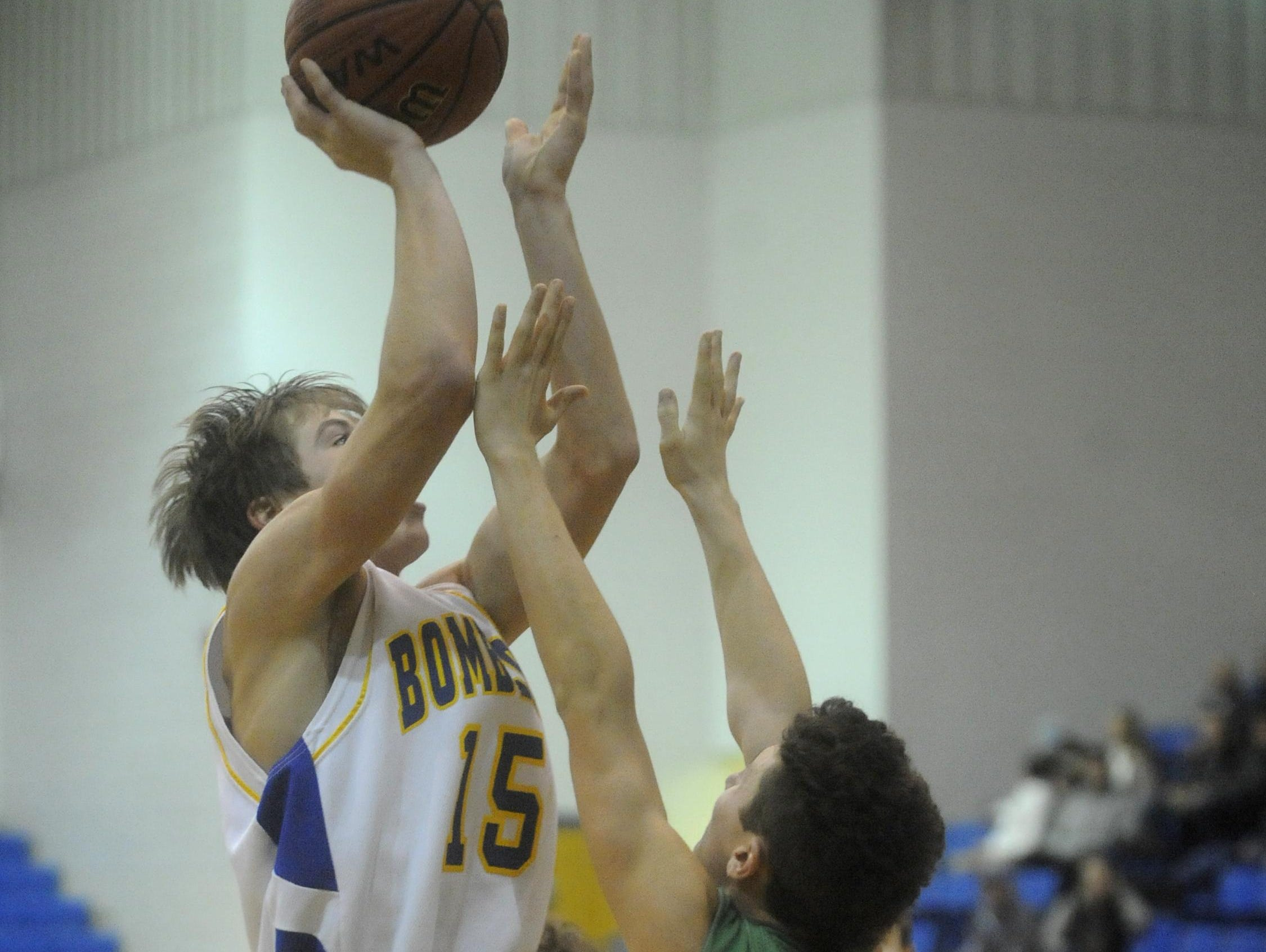 Mountain Home's Mitchell McDonald shoots over a Greene County Tech defender during a recent game at The Hangar.