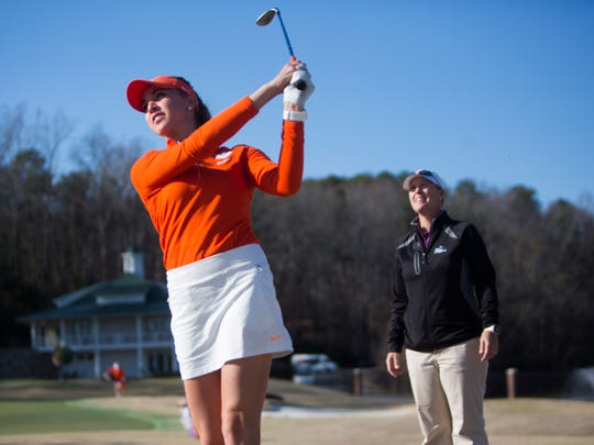 Head coach Kelley Hester watches as junior Marisa Messana hits a shot during Clemson's women's golf practice on Monday, February 13, 2017, in Clemson.