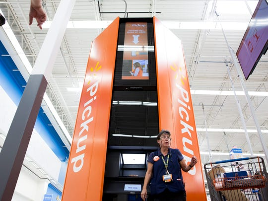 Pickup associate Laura Metz places a customer's order in the pickup kiosk near the front of the Walmart Supercenter just south of I-75 along Collier Boulevard in East Naples on Friday, Sept. 1, 2017. The new kiosk is the first of its kind in Florida and will hold up to 300 orders at one time.