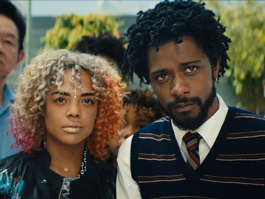 Tessa Thompson as Detroit and Lakeith Stanfield as Cassius Green in 'Sorry to Bother You.'